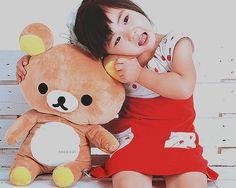 cute asian kid with a teddybear