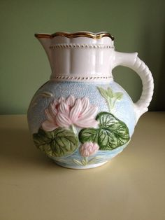 Vintage pitcher after a Majolica Water Lily Pitcher design by Samuel Lear . Compare the modeling and depth of color to pieces of Samuel Lear.