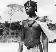 Vintage photo from 1952, young Marron girl from Suriname with scarification and amulets. Her name was Mè-oe-mè