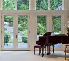 A grand piano that looks out on the luscious green, quiet lawn #home #studio #music