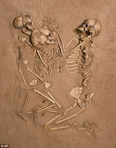 Proof of life: The three skeletons buried at Gobero in the Sahara desert - I saw a documentary where it is suggested that this adult and two children probably drowned.  They were buried on a bed of flowers holding hands with each other.