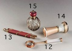 15.A GEMSET ENAMEL GOLD-MOUNTED HARDSTONE SCENT-BOTTLE by Faberg, workmaster Michael Perchin, St. Petersburg, 1896-1908 The globular smoky quartz body carved with waved ribs, the hinged top in pink guilloch enamel, the ruby finial within rose-cut diamond border, chased engraved gold laurel leaf neck,marked inside cover 2in. (5cm.) high