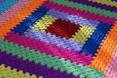 Log Cabin Crochet Blanket- I love the color blocks made like granny squares!
