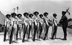 Girls in swimsuits with rifles, ca. 1940s