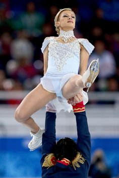 Tatiana Volosozhar and Maxim Trankov of Russia compete in the Figure Skating Pairs Short Program during the Sochi 2014 Winter Olympics at Iceberg Skating Palace on February 6, 2014 in Sochi, Russia.