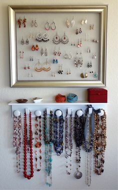 DIY jewelry organizer.  I bought a shelf from Michaels and spray painted it to look like gray stone (its awesome!)  A cheap black picture frame from Target with craft stitch fabric hot-glued to the inside.  I also bought 3 small, cheap wooden boxes from Michaels and painted them to set on top of the shelf and hold watches, earring backs, etc.