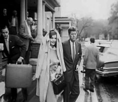 John and Jackie in the rain, 1960