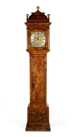 A George II figured walnut longcase clock by Benjamin Gray  Justin Vulliamy. Height: 246.4 cm (97 in). Width: 50.8cm (20 in). Depth: 25.4cm (10 in). www.millingtonadams.com