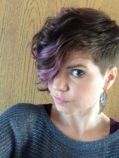 Asymmetrical undercut with purple / curly hair