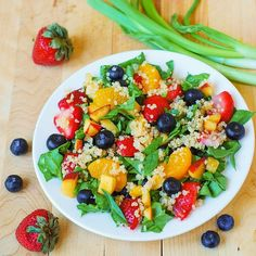 Quinoa salad with spinach, strawberries, and blueberries and a balsamic dressing to die for