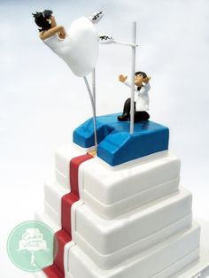 Pole Vaulting Cake for Singapore national pole vaulter Rachel Isabel Yang. One of our most challenging fondant figurines, the bride is completely suspended in mid air supported only by her hands to...