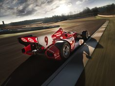 Scott Dixon and Dario Franchitti heat up the track in their Honda-powered IndyCars.