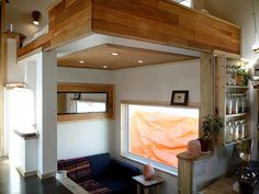 "Leaf House Version.2 Living space = 215.33 sq ft. This pic: living ""room"", with loft bed above."
