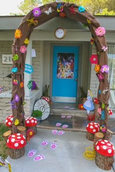 Down the Rabbit Hole and into Wonderland. This was the entrance to my daughter's Alice in Wonderland themed party. I re-purposed an old wedding arch and covered it in brown fabric, colorful flowers, and butterflies to create the rabbit hole. Alice In Wonderland Rabbit, Alice In Wonderland Tea Party, Birthday Party Decorations, Party Themes, Ideas Party, Wedding Themes, Diy Ideas, Wedding Decorations, Backyard Decorations