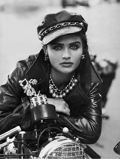 "Supermodel Helena Christensen channeling ""The Wild One"" and striking a very Marlon Brando-esque pose in her Erez leather jacket and Harley-Davidson leather biker cap –Image by © Peter Lindbergh"