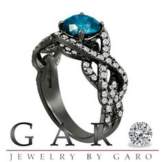 Black gold, blue diamond, two-tiered engagement ring http://www.etsy.com/listing/112268915/vintage-style-14k-black-gold-190-carat