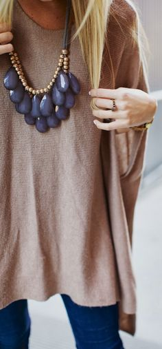 This knit cape looks so chic with a bold necklace. We think it really elevates the look from comfy casual to city chic.