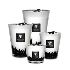"""4 wicks/7 wicks 60-hour/150-hour/800-hour burn time Scent: Black Rose/Oud Wood Max10: 3.9""""HMax16: 6.3""""HMax35: 13.8""""HThe Baobab Collection Feathers Black Scented Candle is an object of decoration perfect for all interiors.Its black inlays placed in hand-blown glass give off a feathered effect. When lit, this candle's flames delicately reveal a warm and elegant light.Its scent is a blend of the fragility of a black rose and the strength of Oud wood, somewhat like the balance of the ying and the ya Bougie Baobab, Cadeau Parents, Barker And Stonehouse, Luxury Candles, Black Feathers, Artisanal, Candle Making, Scented Candles, Aroma Candles"""