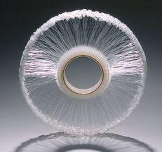 Christel van der Laan - Priceless Bangle, 2004. Gold plated sterling silver, polypropylene swing tags