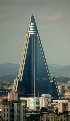 """Ryugyong Hotel is a pyramid-shaped skyscraper under construction in Pyongyang, North Korea. Its name (""""capital of willows"""") is also one of the historical names for Pyongyang. Unusual Buildings, Interesting Buildings, Amazing Buildings, Modern Buildings, Interesting Photos, Architecture Unique, Futuristic Architecture, Interior Architecture, Building Architecture"""