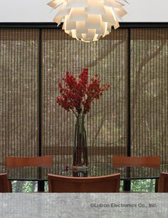 Enrich any room with Lutron's automated shades in woven woods.  www.automation-design.com