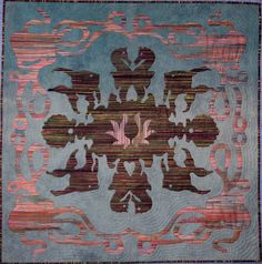 Hawaiian Sealife by Diane Lovitt.  This quilt was made using hand needle turn applique and was hand quilted with metalic thread in the echo Hawaiian style.