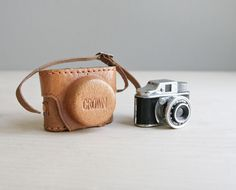 miniature crown spy camera & leather case.