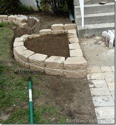 DIY retaining wall/flower bed from DIY Newlyweds blog