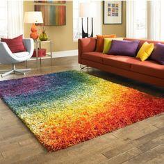 Really cool rug - looks like a rainbow.