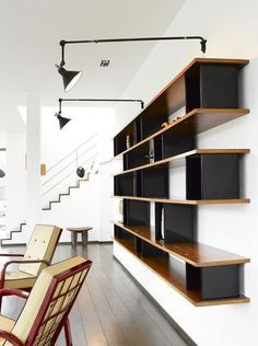 An important and personal bookshelf by Charlotte Perriand, designed for Serge Mouille 1959. Edition Steph Simon. Material veneered walnut an...