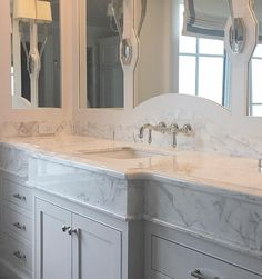 pretty millwork and marble backsplash in bathroom