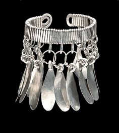 Alexander Calder (1898-1976) Drop Bracelet silver wire 3 1/8 x 2 3/4 x 2 1/4 in. (7.9 x 6.9 x 5.7 cm.) Executed circa 1940.
