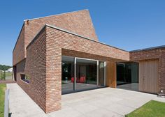 Architect Joris Verhoeven chose hand-moulded bricks for the walls of this asymmetric gabled house in the Dutch village of Riel.