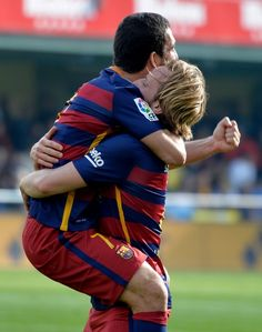 Barcelona's Croatian midfielder Ivan Rakitic celebrates a goal with Barcelona's forward Arda during the Spanish league football match Villarreal CF vs FC Barcelona at El Madrigal stadium in Vila-real on March 20, 2016.
