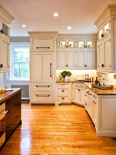 I love a white kitchen. Those little glass cabinets with lights would be great above and below my side cabinets.