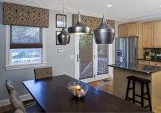 Eclectic, sophisticated dining room and kitchen design with an urban feel. From 1 of 10 projects by Lugbill design, discovered on Porch.com