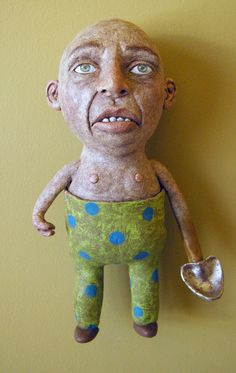 Digger hand built ceramic hanging sculpture