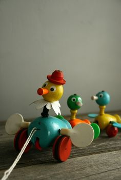 Vintage Fisher-Price pull toy. The ducks spin their wings and quack. I remember this one. I loved annoying my Great grandfather with its quack.