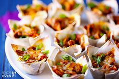 Chicken Enchilada Cups Recipe - ZipList - substitute corn tortillas for the won ton wrappers. Cut each tortilla into fourths, use sugar free, gluten free enchilada sauce of choice. Mexican Dishes, Mexican Food Recipes, Mexican Cheese, Mexican Desserts, Savory Cupcakes, Wonton Cups, Enchilada Recipes, Enchilada Sauce, Enchilada Casserole