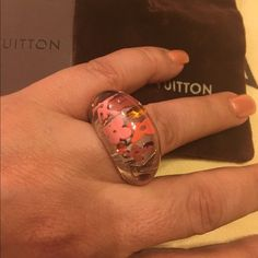 NWT Authentic LV inclusion ring New ring inclusion tangerine color , clear with pink and tangerine, Swarovski crystals. Comes with tags , box and pouch . Perfect condition. Louis Vuitton Jewelry Rings