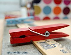 TUTORIAL: Display your children's artwork or even a chore list with this cute wall display system. Made from Jumbo clothespins and a wood yardstick.