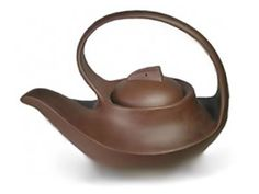 Love this piece, the smooth flowing curves, the suggestion of symmetry and balance, and I'm a sucker for the classic Asian brown lustrous clay finish.