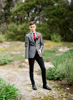 This Australian groom is wearing his red! The bright color looks great on this handsome man heading to his wedding.