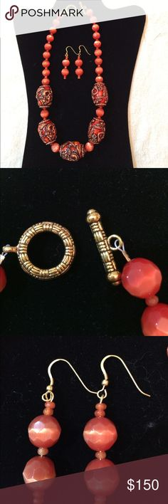 NWOT rare orange jade necklace & earrings Rare orange faceted beads, smaller jade seed beads that are jade with carved oriental ceramic barrels to match. Toggle class, necklace is 20 inches long and earrings are 2 1/4 inches Jewelry
