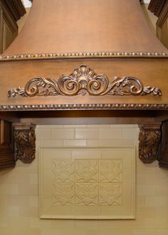 Beautiful hood details, but the corbels don't work with this design and size
