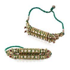 Each with a gold foliate design on a green enamel ground, kundan-set with table-cut 'polki' diamonds, to a pair of 'makara' head terminals, the side and inner edges with a similar foliate design in red, blue and green enamel on a white ground. Indian Jewelry Sets, Indian Wedding Jewelry, Royal Jewelry, India Jewelry, Gold Jewelry, Jewelery, Hair Jewelry, Gold Earrings, Rajputi Jewellery