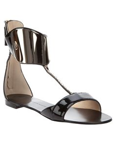 7c5bcb6689d Black patent leather sandals from Giuseppe Zanotti featuring a toe panel