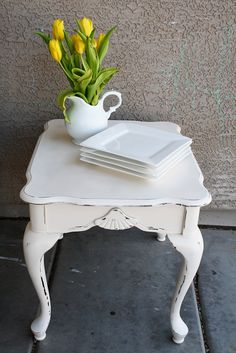 love the punch of color on the antique side table