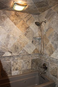 Creating different patterns using the same tile adds interest and variety without overwhelming a smaller space!   Midwest Stone Source   815.395.8677   midweststonesource.com #bathroomideas #bathroom #tile  #MidwestStoneSource #RockfordIL