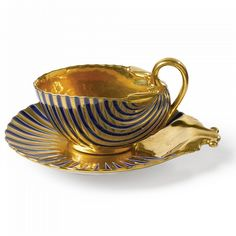 Continental porcelain gold ground shell shaped cup & saucer ci 1810 possibly Paris ,